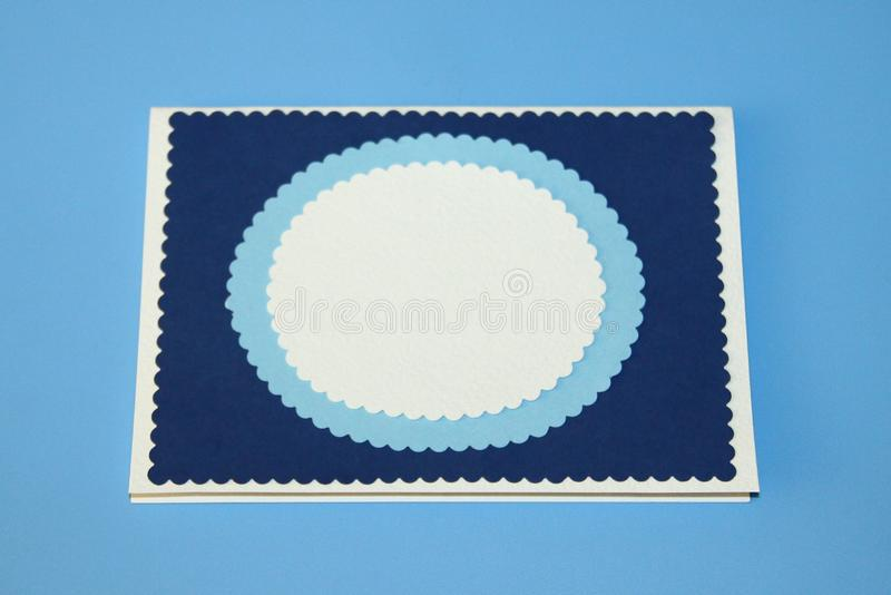 Greeting card blue rectangle with wavy pattern, blue oval with wavy and white outline for text.  stock photography