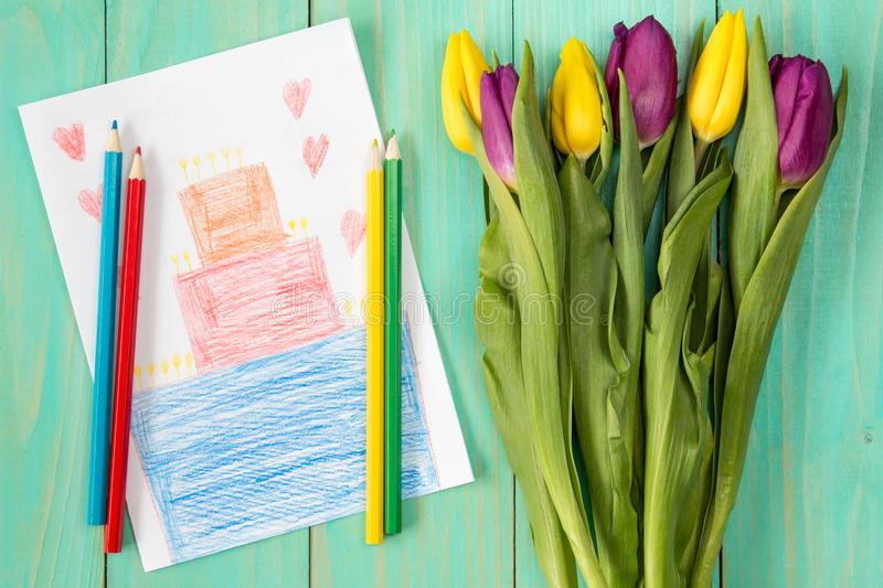 Greeting card and bouquet of tulips stock images