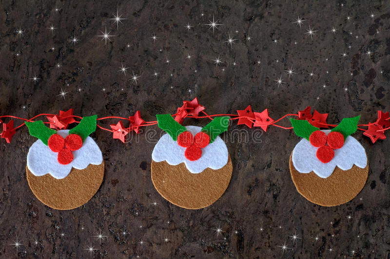 Greeting card christmas decoration pudding from felt with red stars stock photos