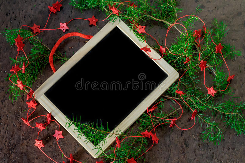 Greeting card christmas decoration with red stars and black chalkboard royalty free stock photo