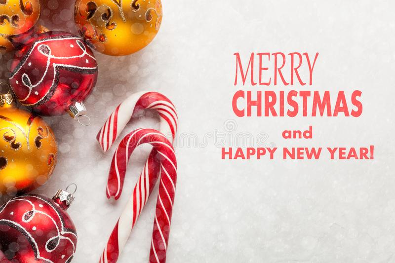 Greeting card with Christmas and new year. The inscription merry Christmas and happy new year on a white concrete. Background with Christmas tree decorations stock image