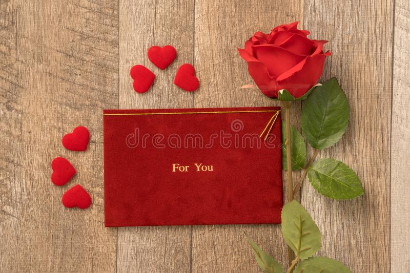 Greeting card concept of giving present and Valentine`s, anniversary, mother`s day and birthday surprise stock image