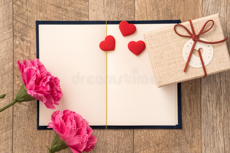 Greeting card concept of giving present and Valentine`s, anniversary, mother`s day and birthday surprise stock photography