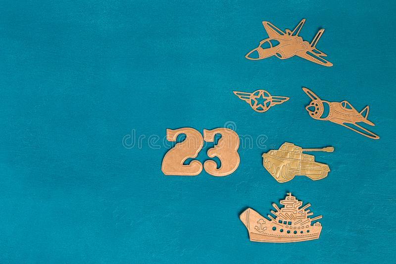 Greeting card dated February 23. Military helicopter, plane, tank, ship royalty free stock image
