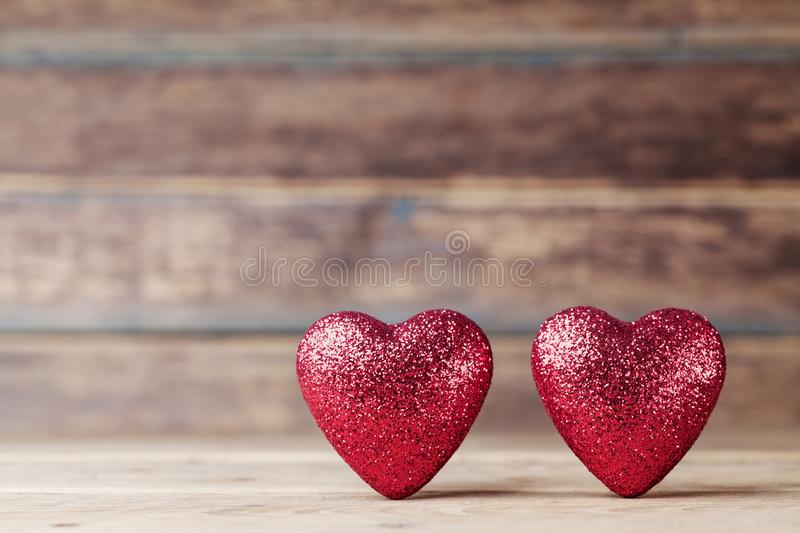 Greeting card for 14 February. Red hearts on vintage wooden table. Valentines day background. Copy space for text. stock image