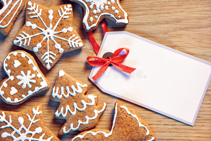 Greeting card with gingerbread cookies. stock photography