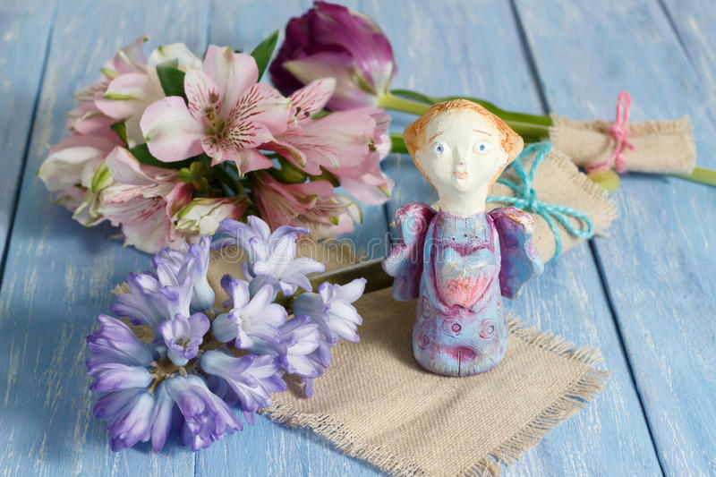 Greeting card with handmade clay angel. Valentine`s day, wedding or birthday concept. Selective focus. Valentine day greeting card with handmade clay angel stock photography