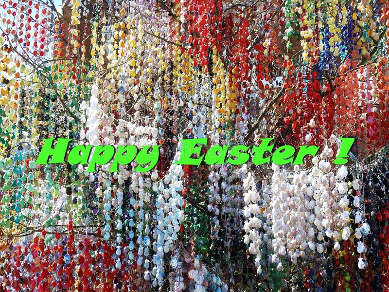 Greeting card - Happy Easter with a lot of easter eggs stock image