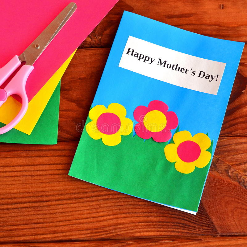 Greeting card Happy mother's day - easy children's crafts. Scissors, paper sheets on brown wooden background stock photography
