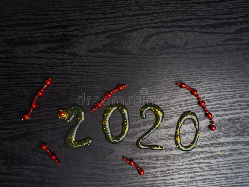 Greeting card Happy New Year 2020. Beautiful Wide Angle creative holiday web banner or billboard with Golden sequins, red garlands. Inscription from slime 2020 royalty free stock images