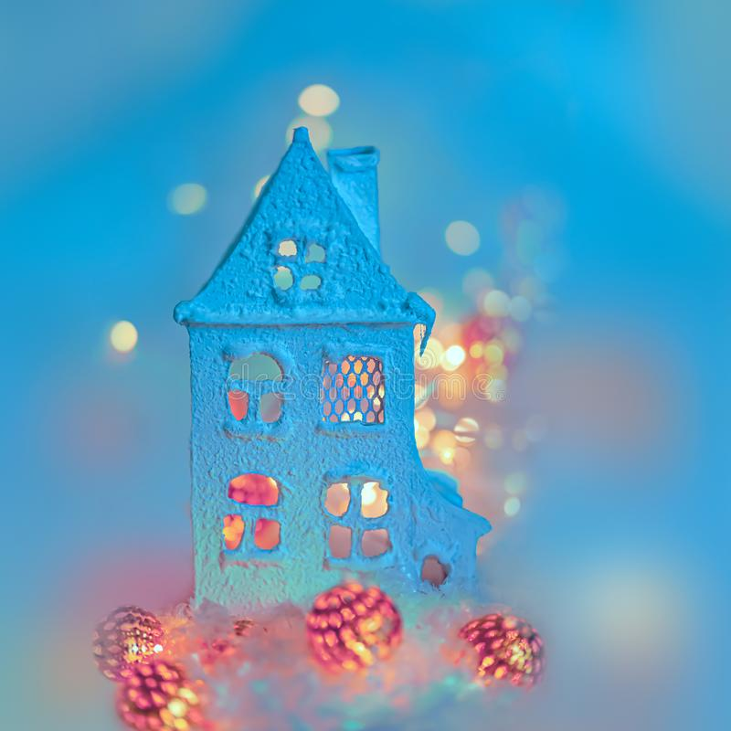 Greeting card Happy New Year and Merry Christmas. Cottage or chalet,  background of winter decoration for the holiday. Copy space. royalty free stock photography