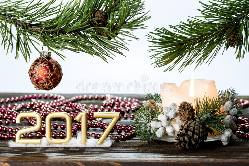 Greeting card happy new year with a twig tree and decorations royalty free stock image