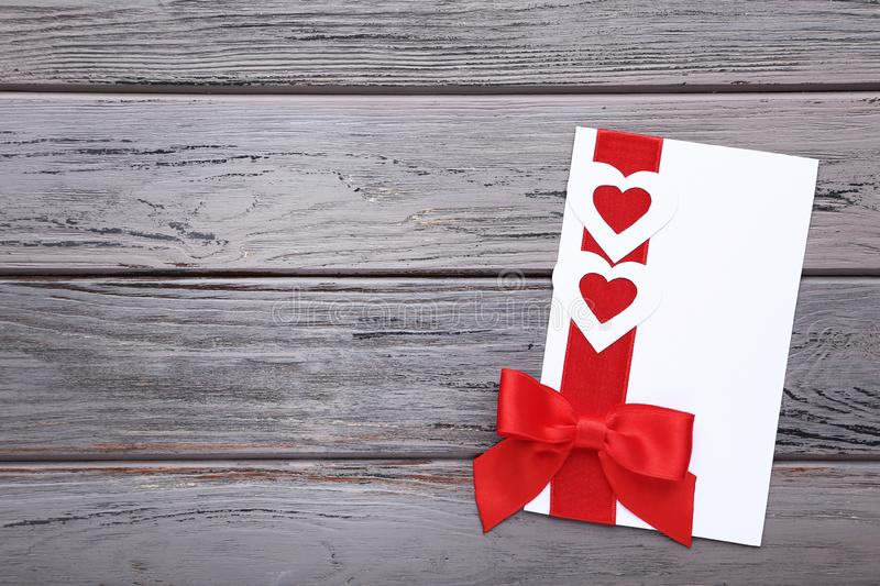 Greeting card with hearts and ribbon stock photo