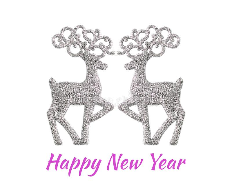 Greeting card with an inscription Happy New Year. Christmas toys in the form of deer of sparkling silver colour. minimal concept, royalty free stock photos