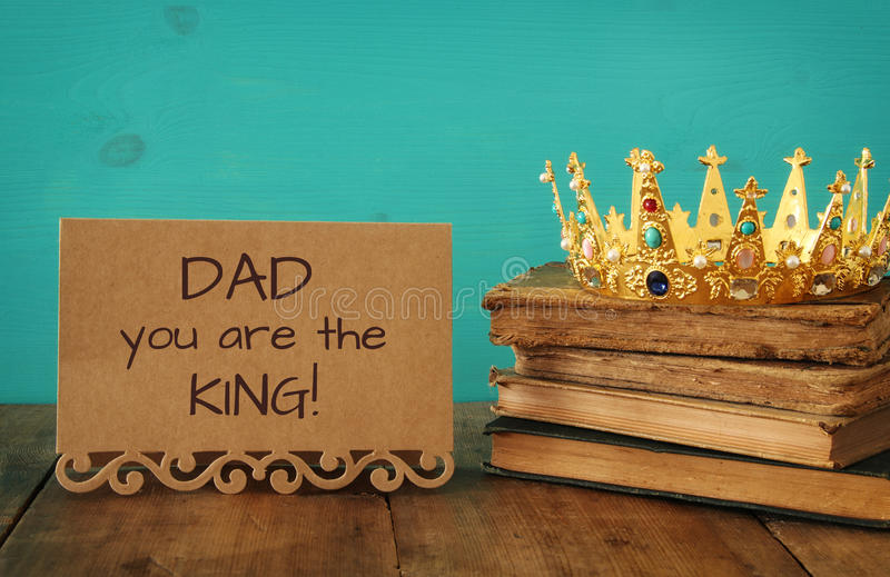 Greeting card and king crown. Father& x27;s day concept. Greeting card and king crown on wooden table. Father& x27;s day concept stock photography