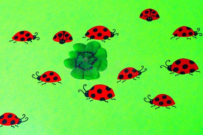 Greeting card with ladybirds and cloverleaf stock photos