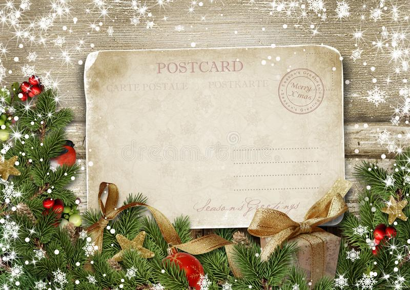 Greeting card Merry Christmas with decorations and vintage postc. Greeting card Merry Christmas with decorations and photo frames on vintage wood with copy-space royalty free stock image