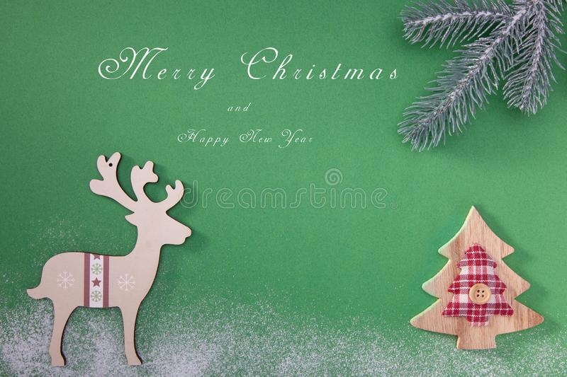 Greeting card with a Merry Christmas tree and snow, a symbol of the holiday, family togetherness. Happy New Year. royalty free stock photo