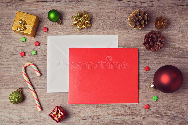 Greeting card mock up template with Christmas decorations on wooden background. View from above. Greeting card mock up template with Christmas decorations on stock photos