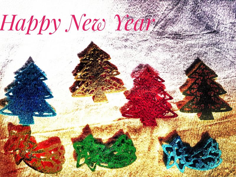 Four fir trees and three falling stars in different colors as a greeting card for the new year royalty free stock photos
