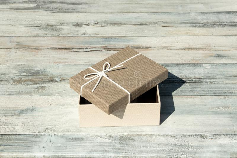 Greeting card. Opened Birthday gift box with white ribbon bow. P royalty free stock photo