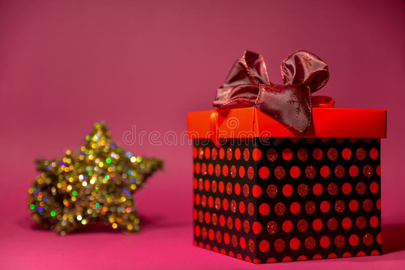 Greeting card with place for text with a big red gift box with a beautiful bow on top royalty free stock photography