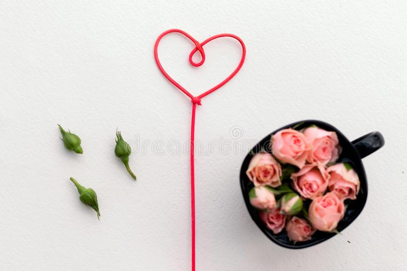 Greeting card for Valentine`s Day, rosebuds, heart, love, background royalty free stock photo
