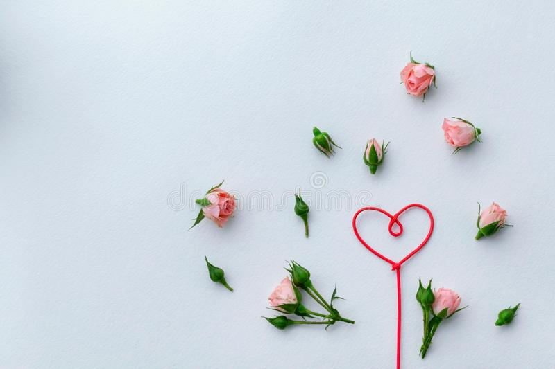Greeting card for Valentine`s Day, rosebuds, heart, love, background. Place for text royalty free stock image