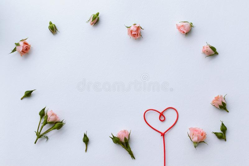 Greeting card for Valentine`s Day, rosebuds, heart, love, background. Place for text royalty free stock photo