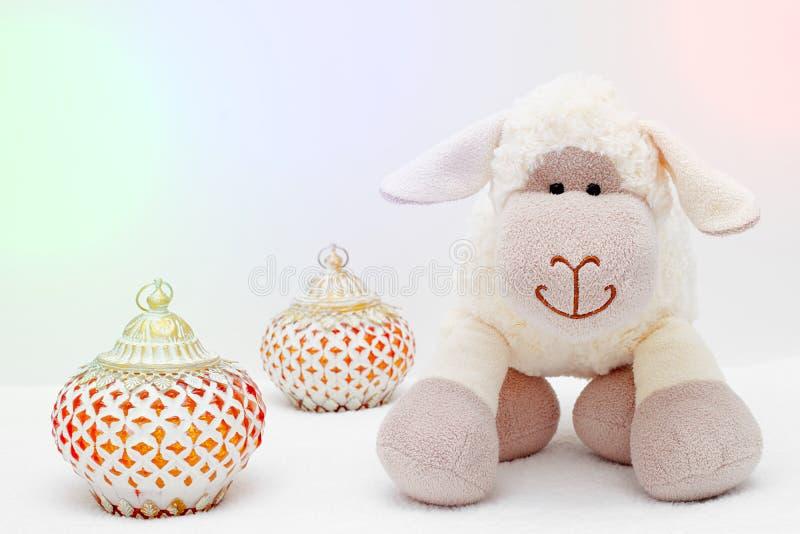 Greeting card on white background. Eid Al Adha sacrifice festival, Islamic Arabic candle and sheep.  stock image