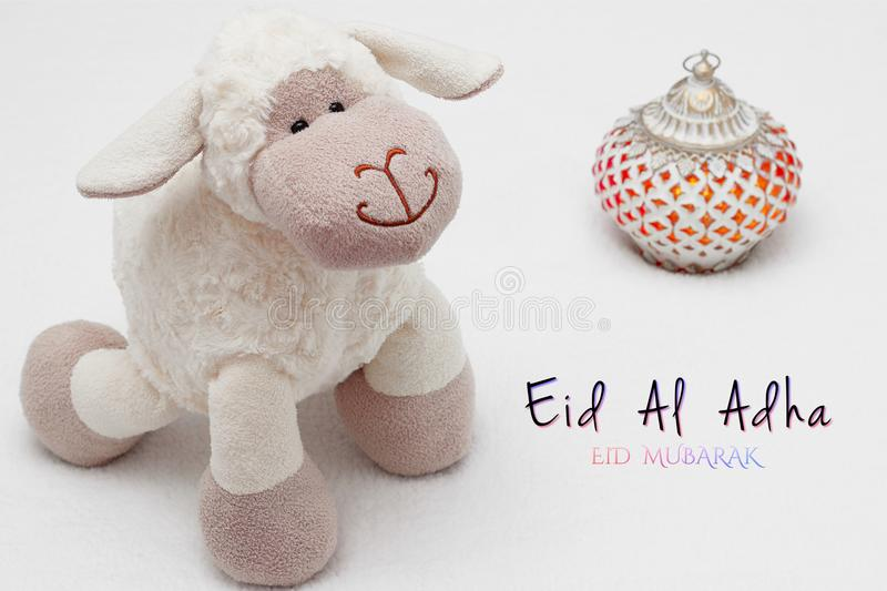 Greeting card on white background. Eid Al Adha sacrifice festival, Islamic Arabic candles and sheep. Eid al adha eid mubarak mean. Greeting card on white royalty free stock photography