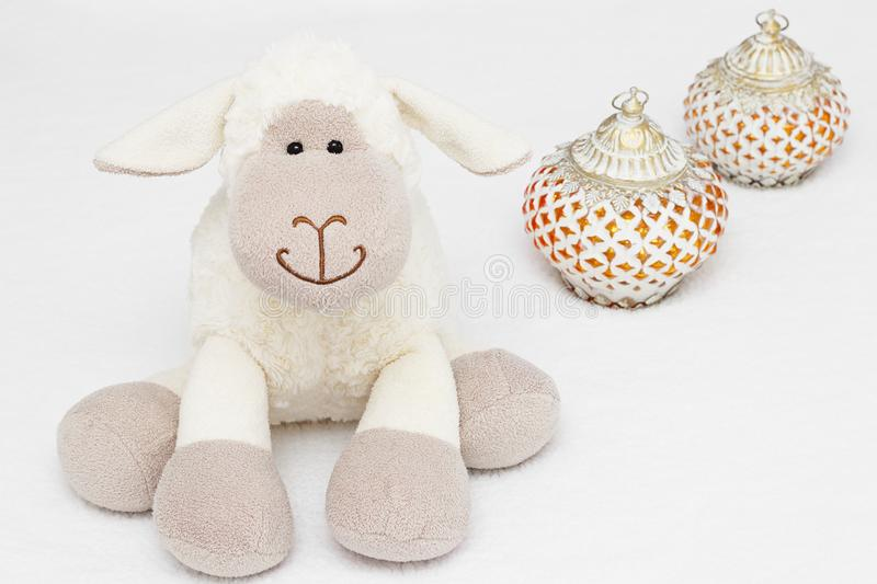 Greeting card on white background. Eid Al Adha sacrifice festival, Islamic Arabic candle and sheep royalty free stock image