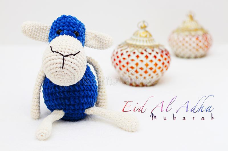 Greeting card on white background. Eid Al Adha sacrifice festival, Islamic Arabic candles and sheep. Eid al adha mubarak means ha. Greeting card on white royalty free stock images