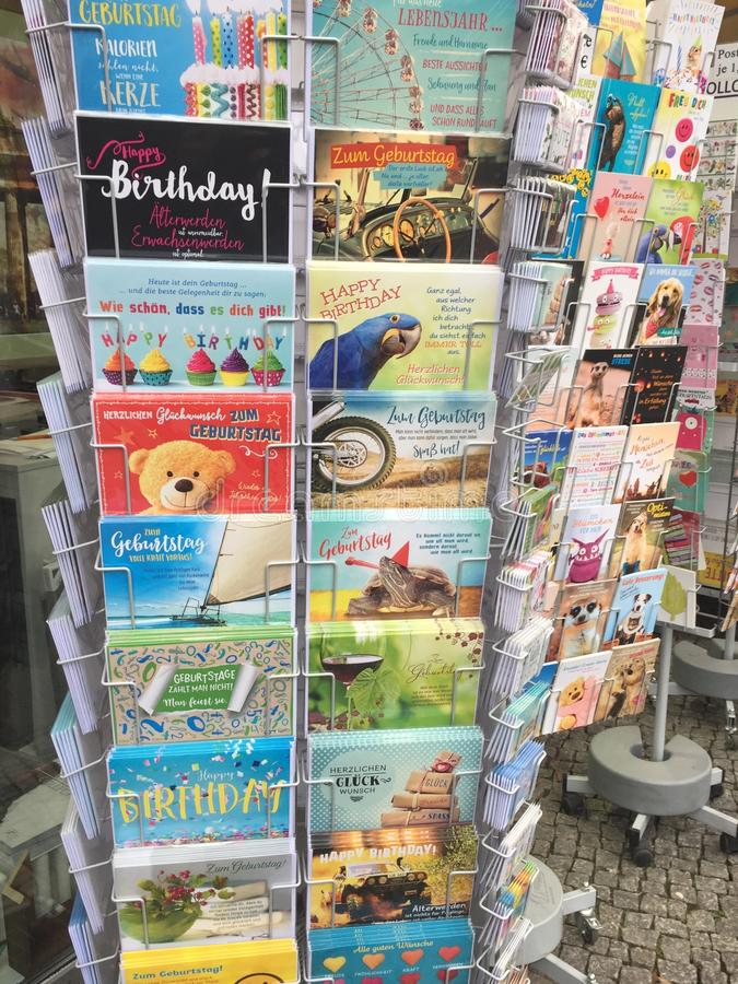 Greeting cards on rack. Berlin, Germany - November 23, 2017: Holder with colourful greeting cards royalty free stock photo