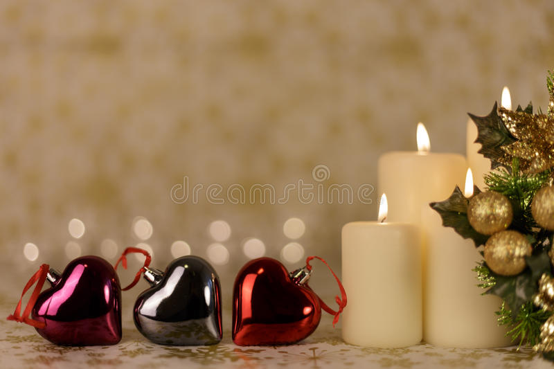 Greeting Christmas card with burning candles and ornaments royalty free stock image