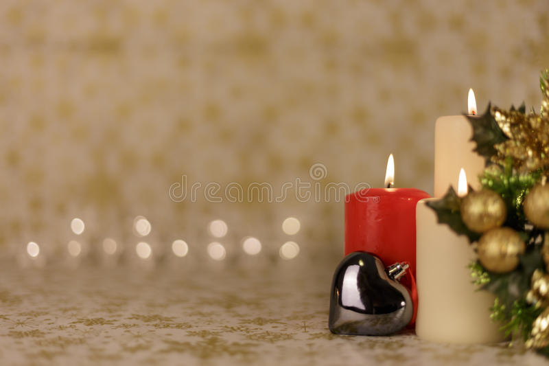 Greeting Christmas card with burning candles and ornaments royalty free stock photos