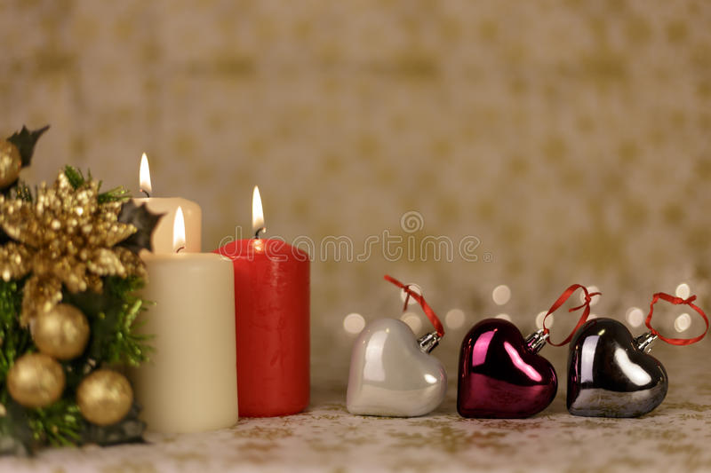 Greeting Christmas card with burning candles and ornaments royalty free stock images