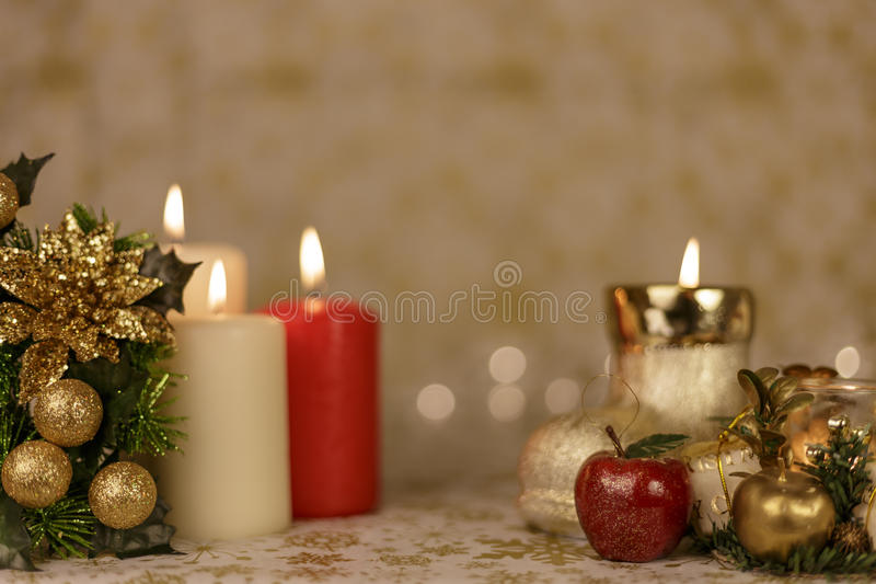 Greeting Christmas card with burning candles and ornaments stock images