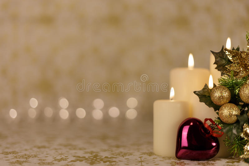 Greeting Christmas card with burning candles and ornaments royalty free stock photography