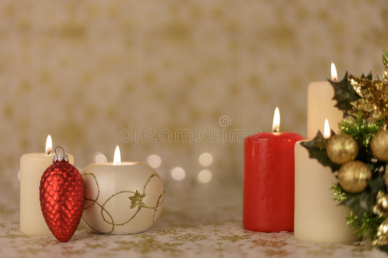 Greeting Christmas card with burning candles and ornaments royalty free stock photo