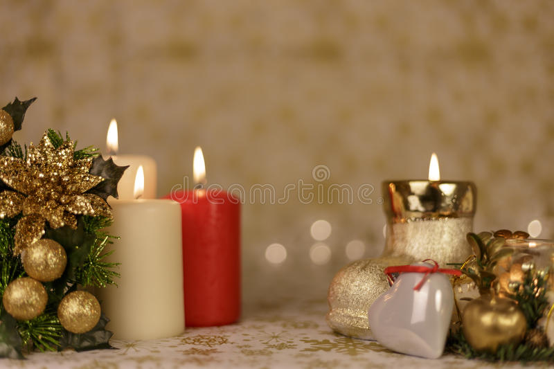 Greeting Christmas card with burning candles and ornaments stock image