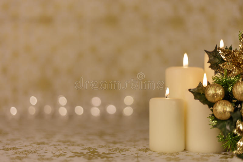 Greeting Christmas card with burning candles and ornaments stock photos