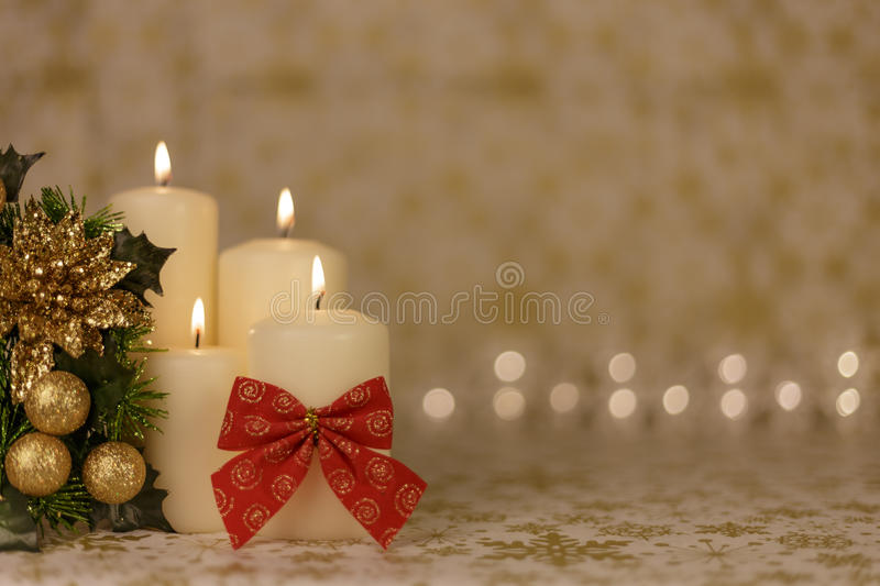 Greeting Christmas card with burning candles and red decoration stock image