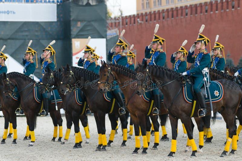 Greeting commander. MOSCOW - SEPTEMBER 9: The Honor Cavalry Escort presentation on International Military Music Festival Spasskaya Tower on September 9, 2013 in stock images