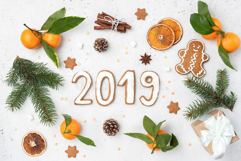2019 greeting with gingerbread cookies, fir tree, decorations stock images