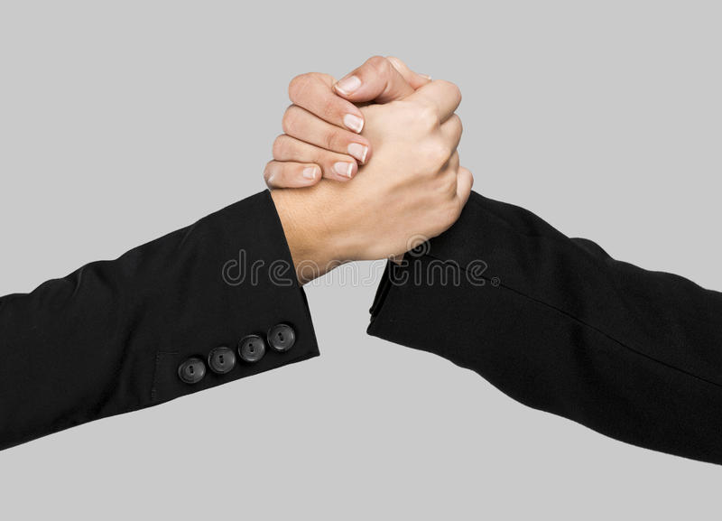 Greeting hands. Over a gray background royalty free stock images