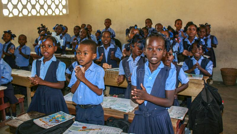 Greeting missionaries in rural Haiti. Uniformed elementary school boys and girls greet visiting missionaries in rural Petit Bourg de Port Margot, Haiti royalty free stock images