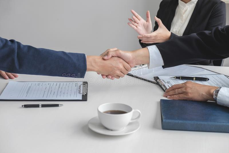 Greeting new colleagues, Handshake while job interviewing, male. Candidate shaking hands with Interviewer or employer after a job interview, employment and royalty free stock photography