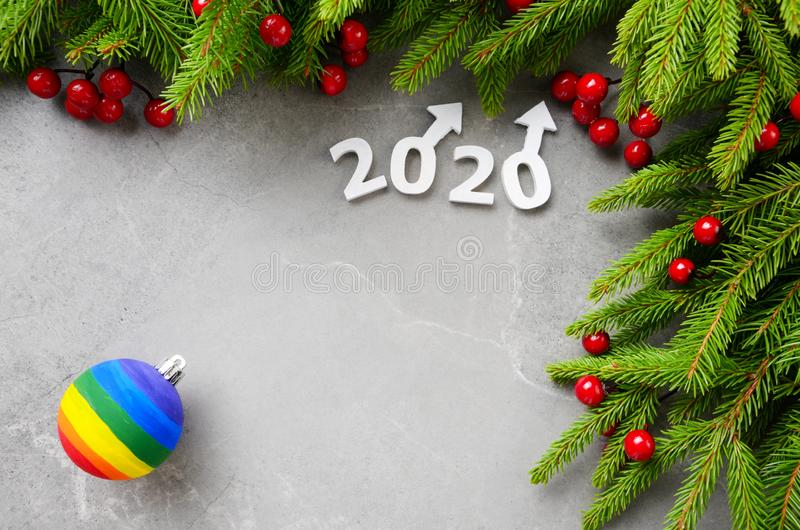 Greeting New Year or Christmas card for 2020 showing two male Mars symbols with fir twigs on stone background stock image