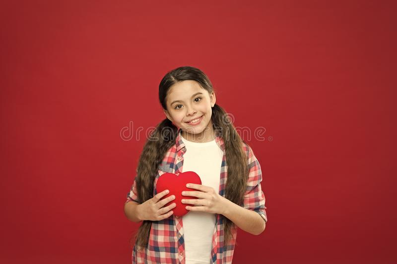 Greeting from sincere heart. Me to you. Girl cute child hold heart symbol love. Celebrate valentines day. Love and stock photo